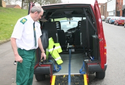 A member of our team preparing one of our Ambulances